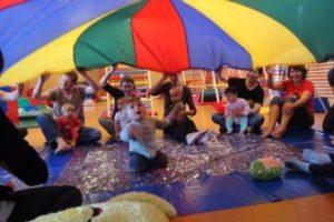 Children and parents under parachute
